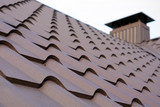 New brown metal tile roof and chimney. - 192373752