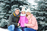 Portrait of happy family in winter park - 192386736