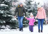 Happy family walking in winter park - 192386755