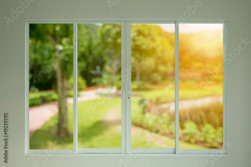 green garden view through the window - 192393115