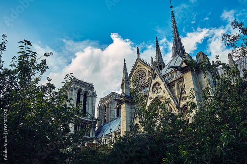 Wall mural Notre Dame with Puffy Clouds