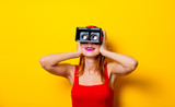 Young redhead girl with virtual reality glasses - 192402991