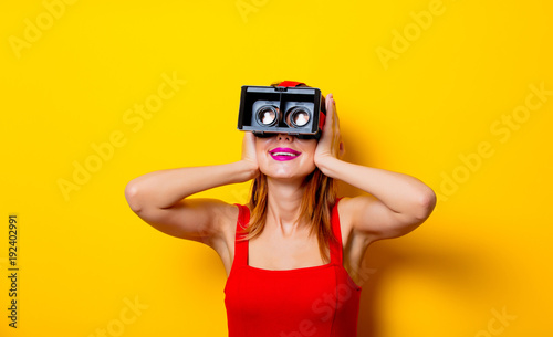 Young redhead girl with virtual reality glasses