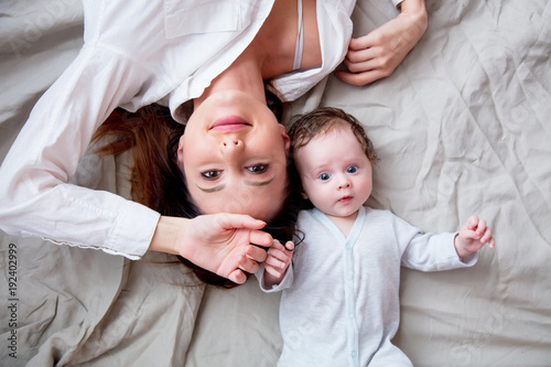 Mother and a little child lying down