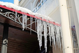 spring icicles on the roof of the building - 192413592