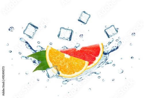 grapefruit and orange splash water and ice cubes isolated