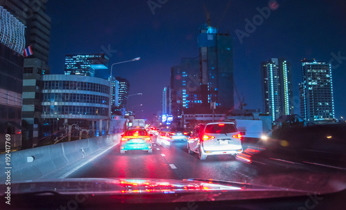 Fotobehang Bangkok Fast moving traffic light trails at night in Bangkok, Blurred background