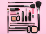 Decorative cosmetics and tools of professional makeup artist on color background - 192419931