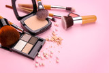 Decorative cosmetics and tools of professional makeup artist on color background - 192419934