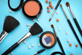 Decorative cosmetics and tools of professional makeup artist on color background - 192419937