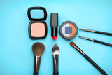 Decorative cosmetics and tools of professional makeup artist on color background - 192419947