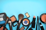 Decorative cosmetics and tools of professional makeup artist on color background - 192419949
