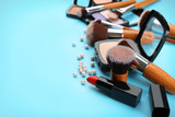 Decorative cosmetics and tools of professional makeup artist on color background - 192419951
