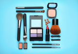 Decorative cosmetics and tools of professional makeup artist on color background - 192419953
