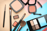Decorative cosmetics and tools of professional makeup artist on color background - 192419967