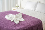 Crumpled towel on comfortable bed in room - 192419968