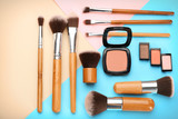 Decorative cosmetics and tools of professional makeup artist on color background - 192419971