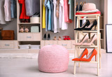 Pink ottoman chair and stand with shoes in dressing room - 192420184