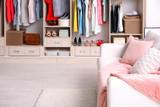 Cozy sofa and big wardrobe in dressing room - 192420186