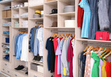 Big wardrobe with different clothes for dressing room - 192420196