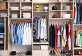 Big wardrobe with different clothes for dressing room - 192420197