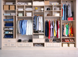Big wardrobe with different clothes for dressing room - 192420198