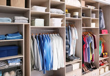 Big wardrobe with different clothes for dressing room - 192420199