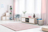 Spacious pink living room interior