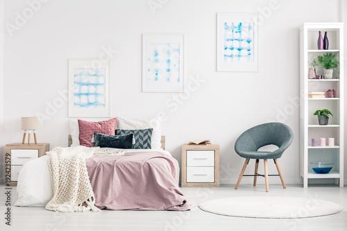 Pastel bedroom interior with armchair