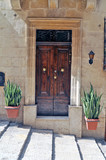 Fototapeta  - Old destroyed door from a Maltese townhouse © karolinaklink