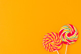top view of sweet lollipops isolated on orange - 192432990