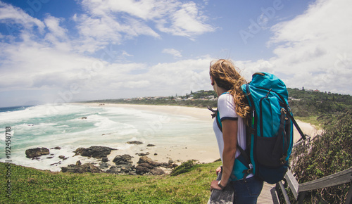 Traveler woman with backpack looking the ocean