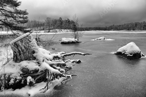 Monochromatic winter landscape with frozen lake - 192466145