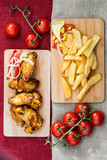 Chicken wings with sauce and golden French fries potatoes - 192471532