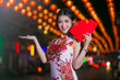 Portrait beautiful Asian woman in Cheongsam dress(Red Chinese dress), Happy Chinese new year concept with night light.