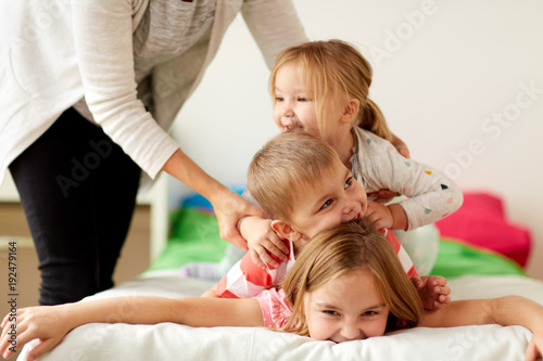 mother and happy little kids having fun at home