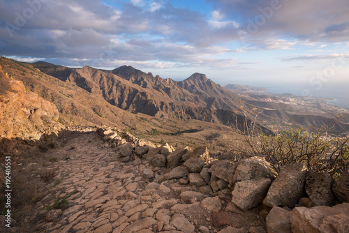 Fotobehang Canarische Eilanden Tenerife mountain landscape. Trekking path. Adeje and Las Americas coastline in the background.