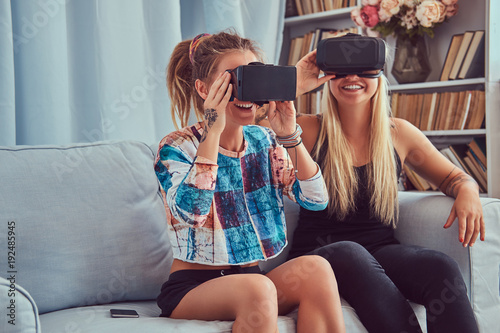 Two young girlfriends in casual clothes having fun