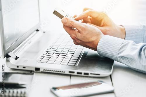 closeup of a businessman using a calculator