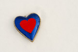 The shape of a blue and red heart on the snow in winter, February 14 - Valentine's Day - 192501136