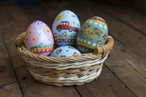 Painted eggs lie in a basket, wooden background, easter - 192501308