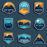 Set of nine mountain travel emblems. Camping outdoor adventure emblems, badges and logo patches. Mountain tourism, hiking. Forest camp labels in vintage style - 192520504