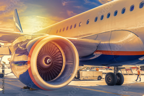 Plane close up engine with blue sky and clouds