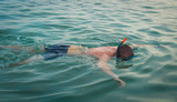 Snorkeling man wearing snorkel and mask summer holidays vacation enjoying recreational leisure time swimming in the sea. - 192530726