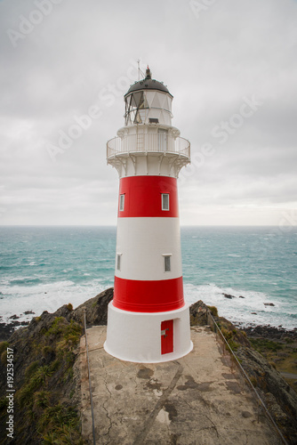 Aluminium Vuurtoren Close up of a light house with the oceand in the background at Cape Palliser, New Zealand.