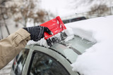 Cleaning snowy car in winter - 192535903