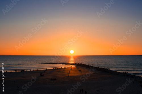 Foto op Aluminium Zee zonsondergang Sunset. Sunset on the beach. Cádiz. Picture taken – February 10, 2018.