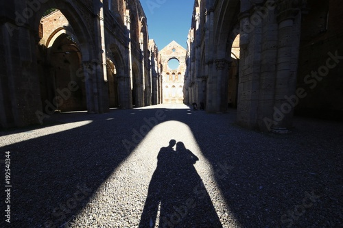 Fototapeta shade of a couple in an abandoned church in Tuscany, Italy