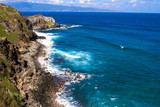Volcanic rock, surf, and shades of the blue Pacific Ocean on the Maui coast, with the island of Molokai in the background - 192547971