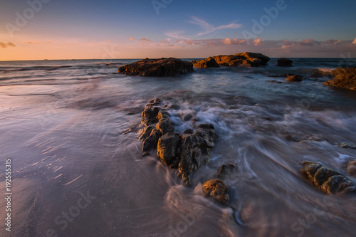 Aluminium Lavendel long expose sunset seascape with waves trails. image contain soft focus due to slow shutter.